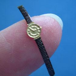 "Round ""Gold"" Watch with Black Strap"