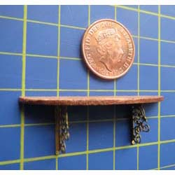 Wooden Shelf with Brass Brackets