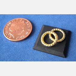"Display Square with 2 round ""Gold"" Bracelets"