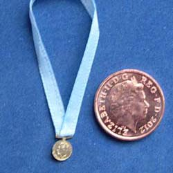 Winners Medal on Blue Ribbon